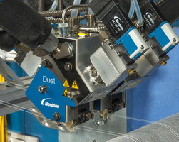 Duet applicators improve adhesive use and performance in elastic attachment