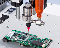 Nordson EFD's silicone dispenser, the xQR41 MicroDot needle valve, applying silicone onto a printed circuit board (PCB) of a medical device.